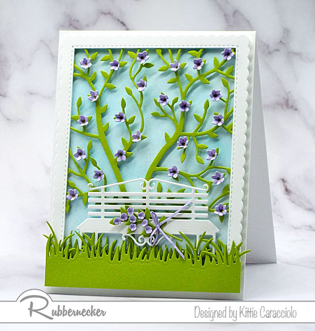 I love creating feminine greeting cards with floral themes and pretty color combinations. Click on the card to see how I made this pretty card using dies by Rubbernecker.