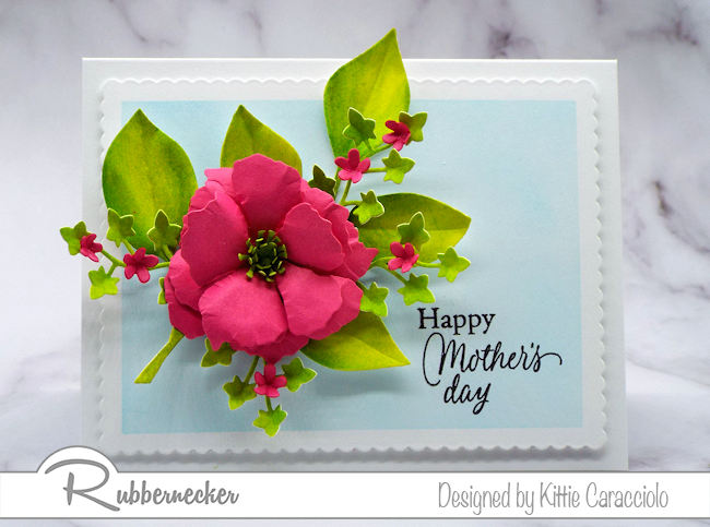 Bright, colorful flowers and foliage are the perfect embellishment on a happy Mother's Day card. Click on the picture to see how I made this using dies by Rubbernecker Stamps.