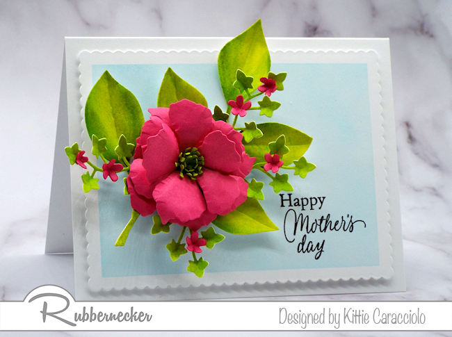 Bright, colorful flowers and foliage are the perfect embellishment on a happy Mother's Day card. Click on the card to see how I made this using dies by Rubbernecker Stamps.