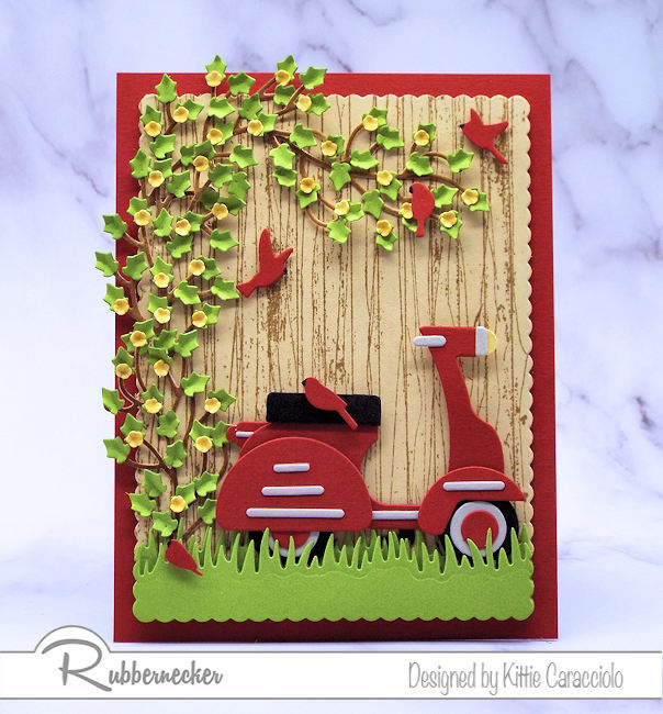 I had so much fun making this scooter card with the wood fence background. Click on the card to see how I made this using dies made by Rubbernecker.