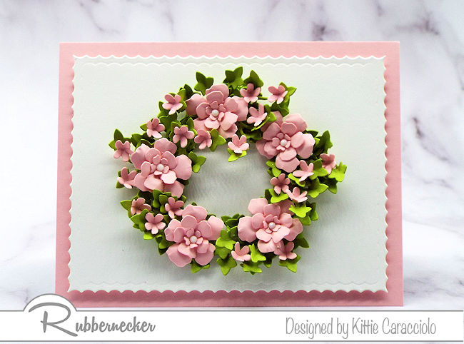 I love making a wreath card with a clean and simple background. Come see how I made this wreath using dies by Rubbernecker.