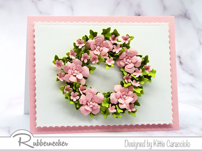 I love making a wreath card with a clean and simple background. Come over to see how I made this wreath using dies by Rubbernecker.
