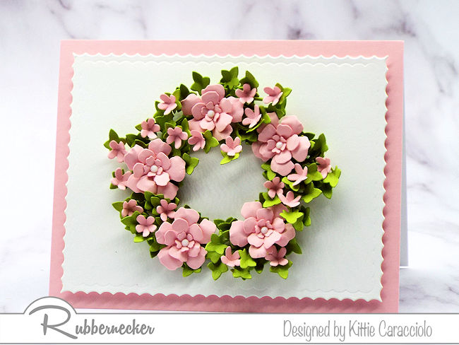 I love making a wreath card with a clean and simple background. Click through to see how I made this wreath using dies by Rubbernecker.