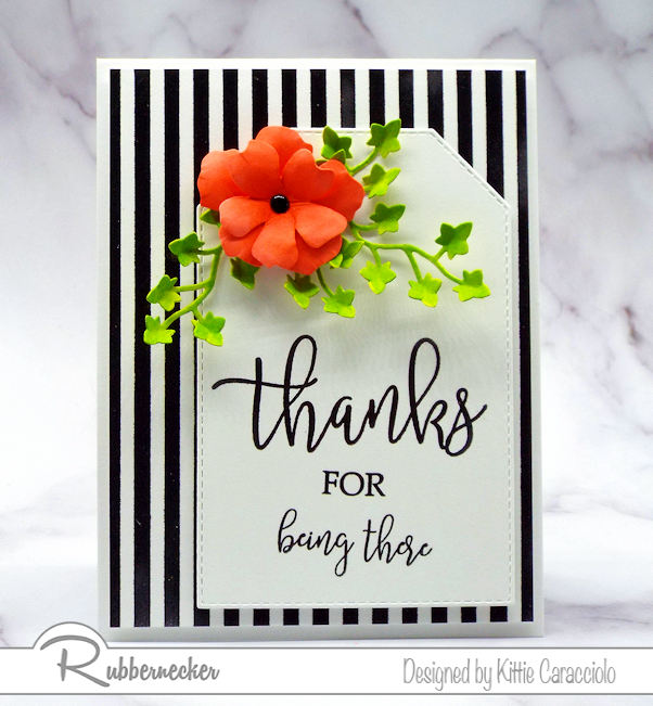 Brightly colored images look so pretty against a black and white background.  Rubbernecker has a big collection of background stamps to use in cardmaking.
