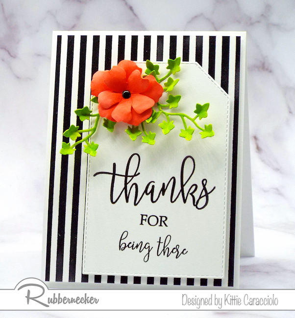 Brightly colored images look so pretty against a black and white background.  Rubbernecker has a great collection of background stamps to use in cardmaking.