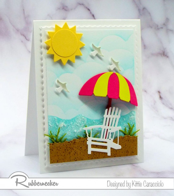 Come over to my beach scene post to see my tutorial on how to create seafoam with embossing paste and sparkly glitter.