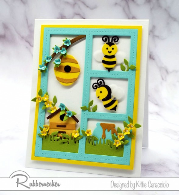 This sweet framed honey bee card was made using the newly released Rubbernecker Bee with Hive and Bee with Honey Pot sets.