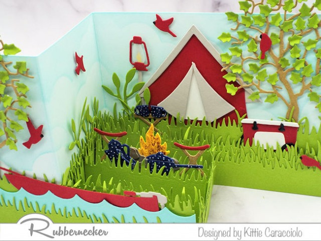 This Z Fold camping card is full of die cut images that work together to create a fun dimensional scene.