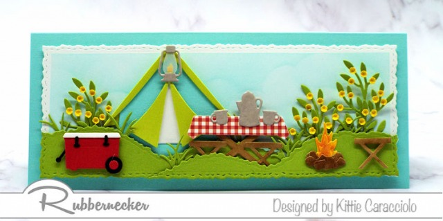 A slimline camping card loaded with lots of die cut paper pieced details