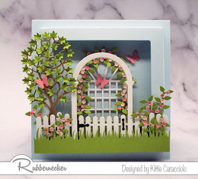 If you love to create cards with lots of dimension you will definitely want to check out this square shadow box frame by Rubbernecker.