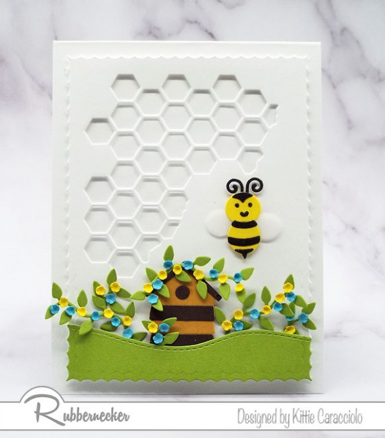 And adorable handmade greeting card using die cuts and a honeycomb background.