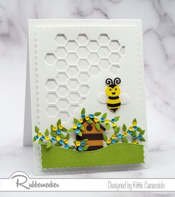 A dimensional handmade greeting card using paper pieced die cuts and a die cut honeycomb background.