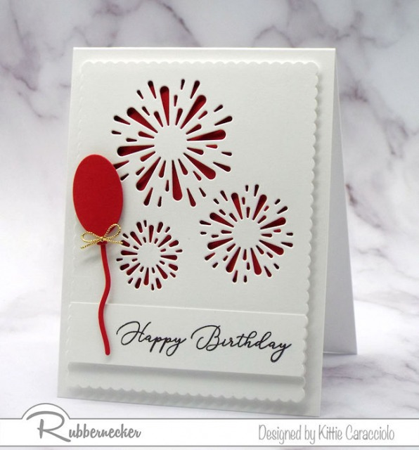 A handmade greeting card showing Negative Die Cuts used to make see-through windows forming fireworks
