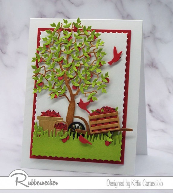 A handmade greeting card with a die cut apple tree made using a leaf die cut in many multiples