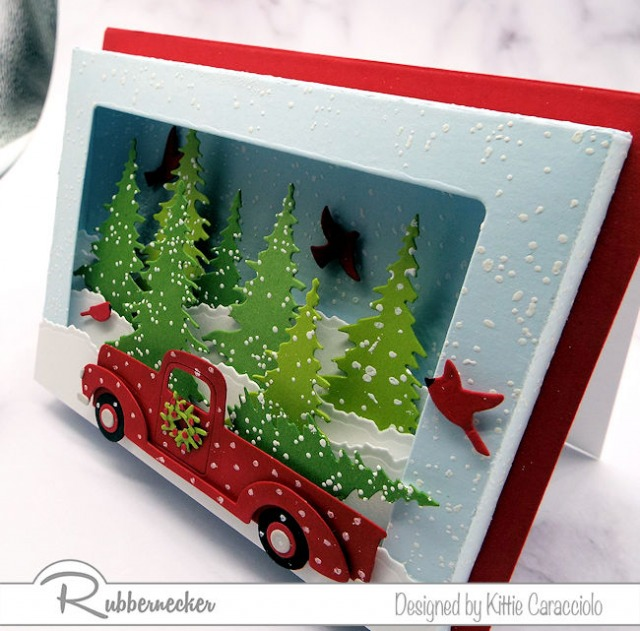 A closeup side view of the card base and decorated die cuts used on a shadow box card die to make a dimensional card