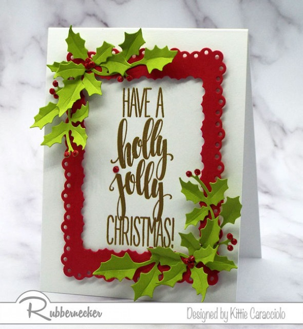 One of my handmade Christmas card ideas that can be easily modified using one oversized greeting stamp, a frame die cut and die cut greenery all from Rubbernecker