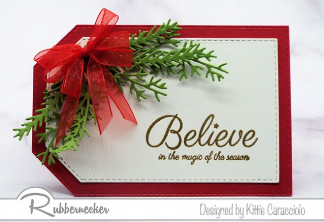One of my DIY Christmas gift tags made using a fast and simple grouping of die cut greenery, one bow and a stamped greeting
