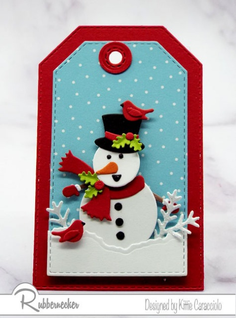 One of today's snowman tags made from die cuts from Rubbernecker loaded with details like tiny mittens, a snappy top hat and miniature cardinals