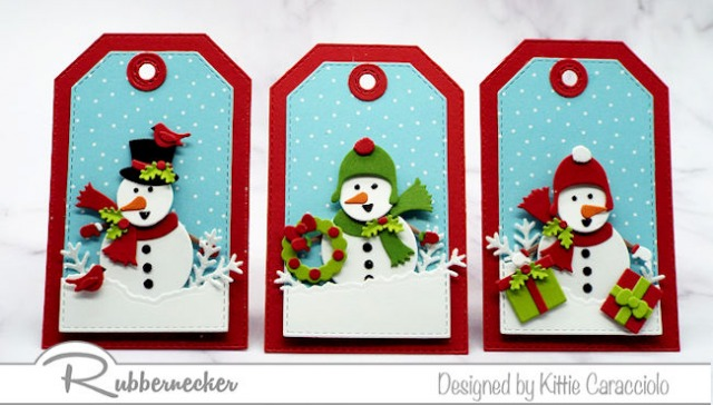 a set of three snowman tags made using die cuts showing different holiday themed scenes