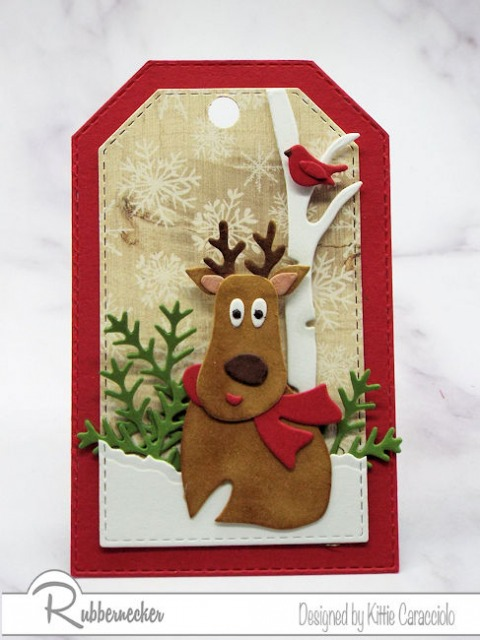 One of my diy gift tags showing an adorable die cut reindeer in his snowy bitch woods home all made using die cuts from Rubbernecker
