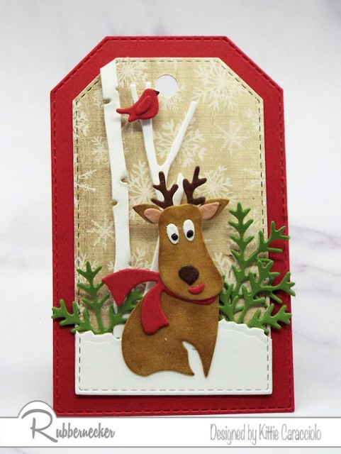 One of today's reindeer themed diy gift tags showing a die cut reindeer in a wintry birch woods