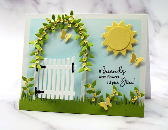 This summery garden gate card is made with die cuts from Rubbernecker and is perfect to send to a friend who could use a smile
