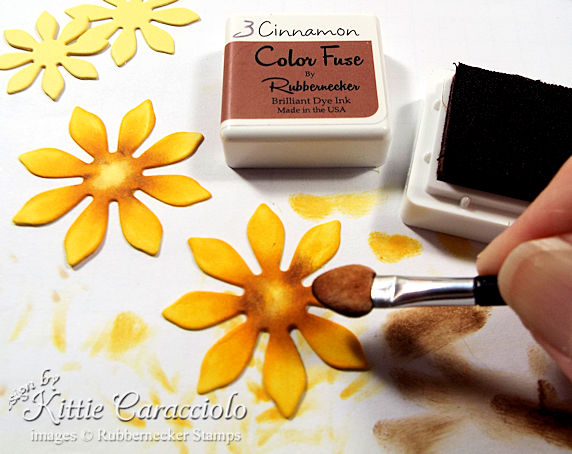Yellow die cut petals shaded with brown ink will be used to make a stunning die cut sunflower - paper flower tutorial shared in today's post