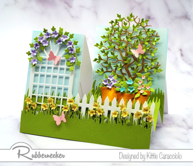 There's no shame in starting with a premade stair step card, especially when you are able to create this detailed garden scene from die cuts from Rubbernecker