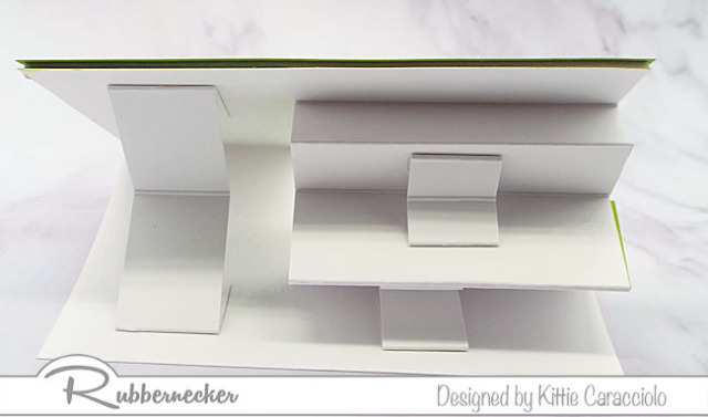 You can see the construction of the timesaving premade stair step card and how adding details creates tons of dimension