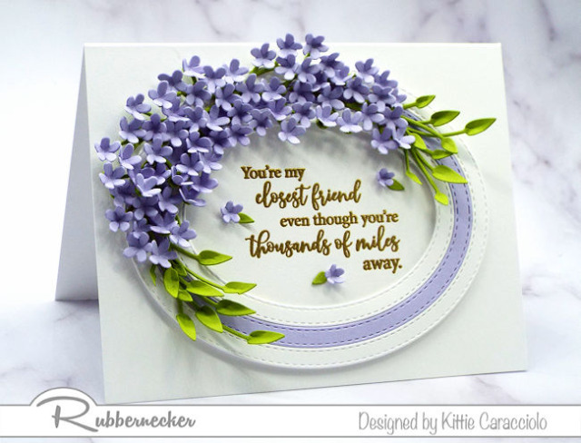 Learn how to make tiny paper flowers from me and you can recreate this stunning handmade greeting card with an oval triple frame decorated with a mass of minute purple blossoms