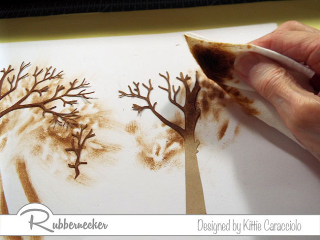 I used tree trunks inked up with a baby wipe and dark brown ink over kraft colored die cuts on my shutter card design