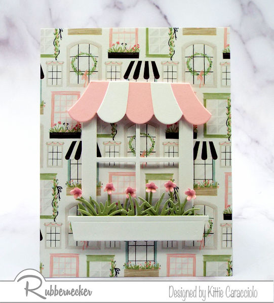 Make cards with patterned paper as a background to die cut details like this window from Rubbernecker adorned with an awning and cute flower box
