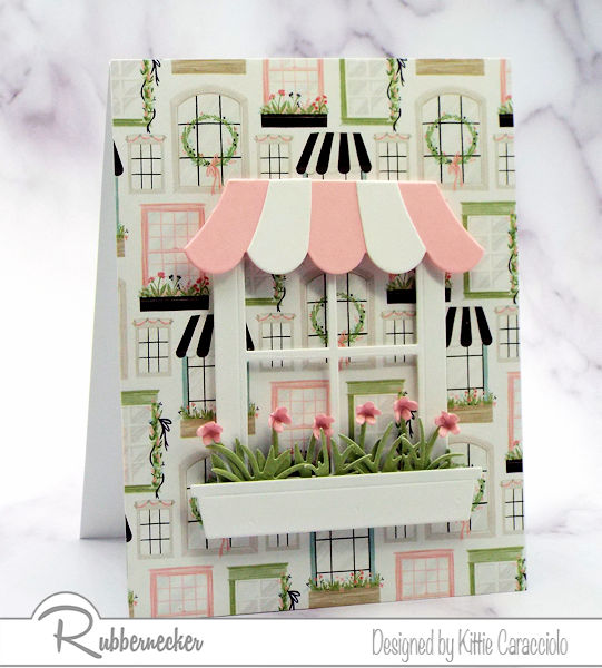 handmade cards with patterned paper as a background with an adorable die cut window, awning and flower box all from Rubbernecker