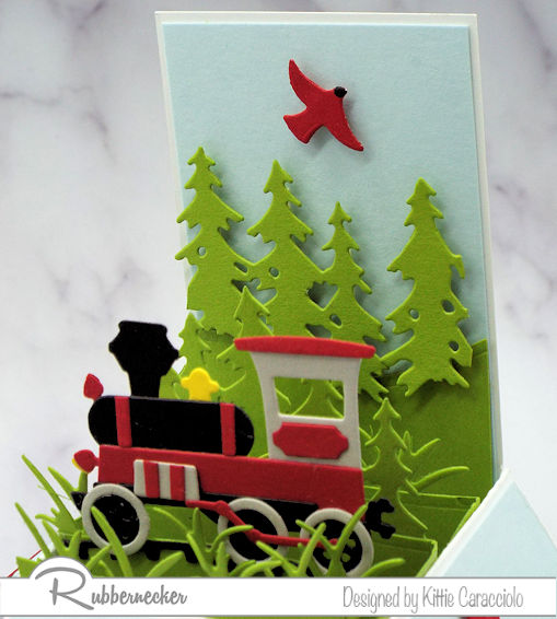 The main feature on today's pop up explosion card in a vintage train theme all made from paper using dies from Rubbernecker