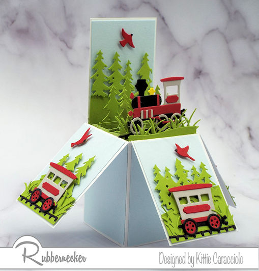 See how to make a pop up explosion card with a vintage train theme like this one made using dies from Rubbernecker