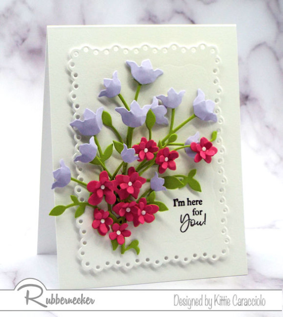 These tiny paper blossoms made from die cuts arranged on a handmade card are the final project in today's tutorial on how to make paper flower card embellishments