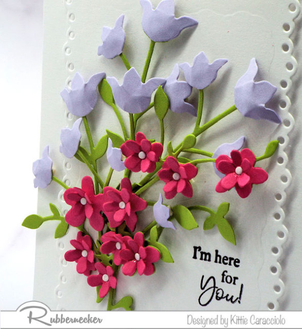 A close up view of adorable tiny paper blossoms on today's handmade greeting card showing how to make paper flower card arrangements