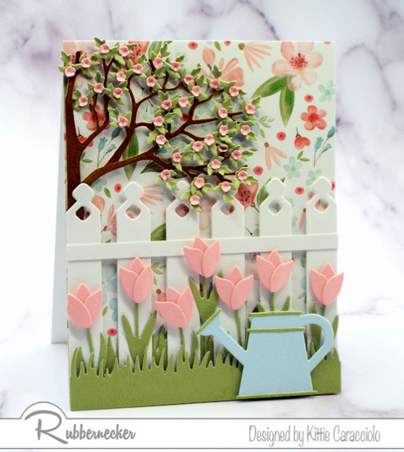 a card made with die cuts in a pretty spring theme with both large and small shapes combined to add the perspective of distance