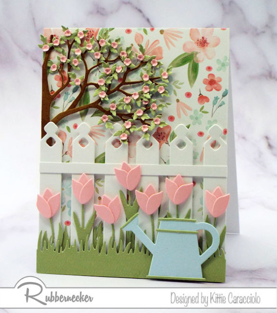 a card made with die cuts that are larger in the foreground and smaller die cut elements in the background for some easy perspective
