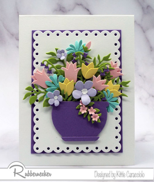 New flower die cut sets are available from Kittie Kraft by Rubbernecker and this card with its card stock flowers in a stunning arrangement show them all off at once