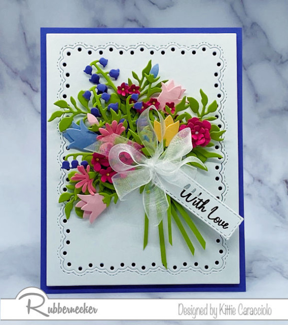 ways to use leftover die cuts shown with a beautiful, lush bouquet of paper flowers on a handmade greeting card