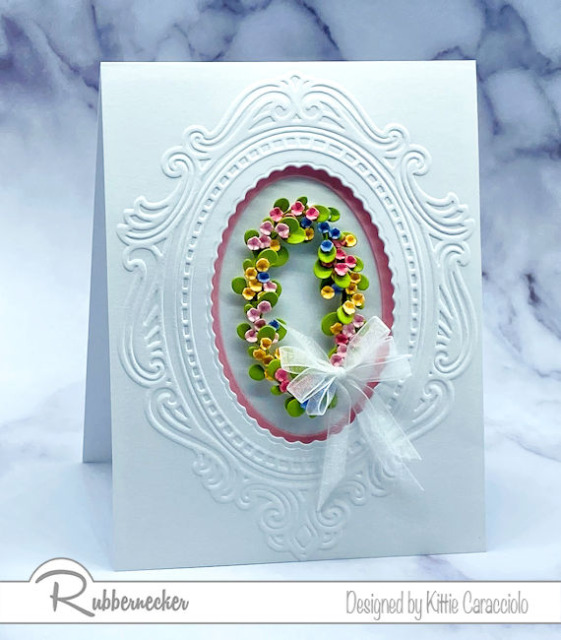 die cut leftovers were used to make this beautiful flower frame on this handmade greeting card