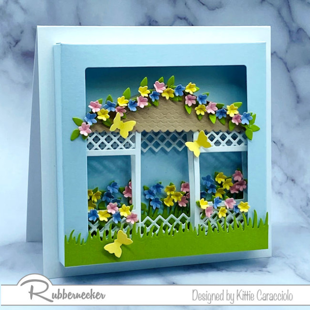 a floral gazebo card tucked into a shadow box frame all made using clever dies from Rubbernecker