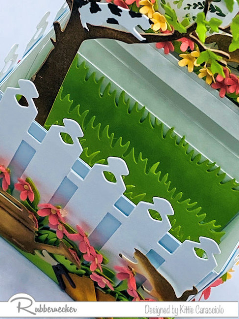 a peek at the inside of an amazingly detailed box fold pop up card created with dies from Rubbernecker
