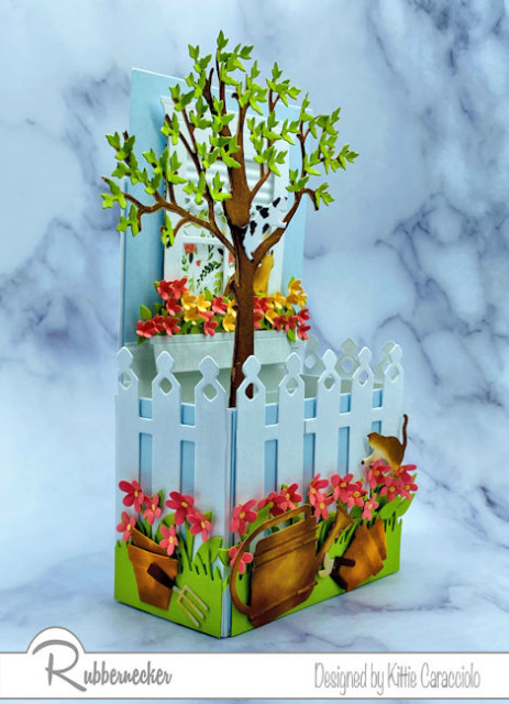 Come learn how to modify a box fold pop up card made using a premade template and some incredible card making dies from Rubbernecker