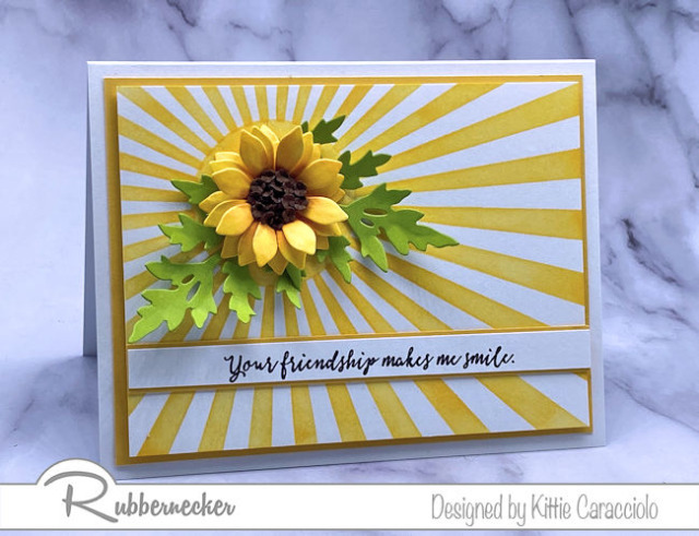stencils and die cuts from Rubbernecker make this card with its beautiful paper sunflower