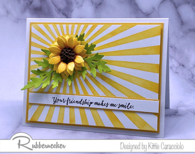 stencils and die cuts were used in combination to create this dramatic card with a beautiful paper sun flower made using products from Rubbernecker