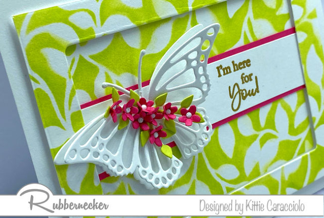 A close up detail of the die cut butterfly on a handmade greeting card created with stamps, dies and a leaf stencil all from Rubbernecker