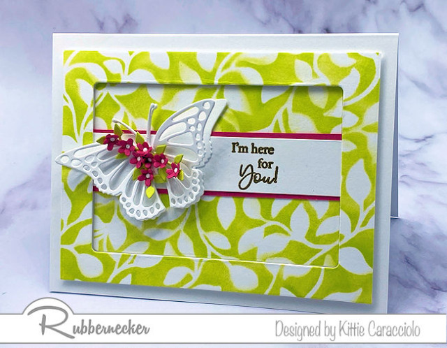 This bright and summery background on this handmade card was made using a new leaf stencil from Rubbernecker