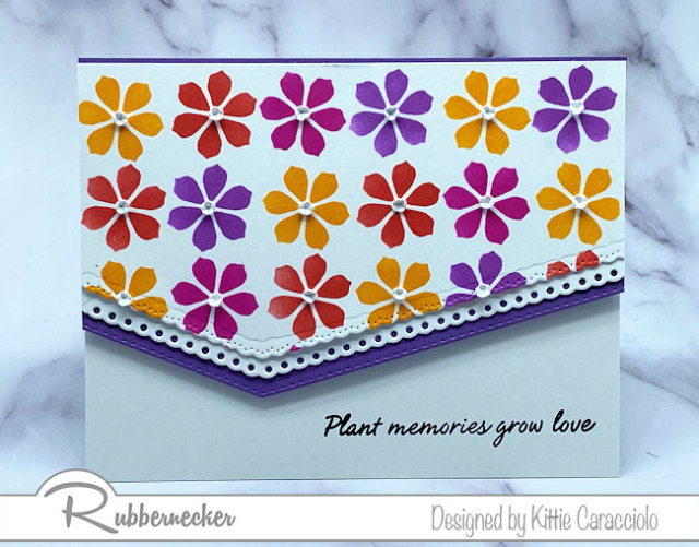 once you how to use a rotating stencil you can create multi colored flowers like these on this handmade card in a perfect pattern